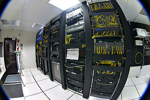 Racks of telecommunications equipment in part ...