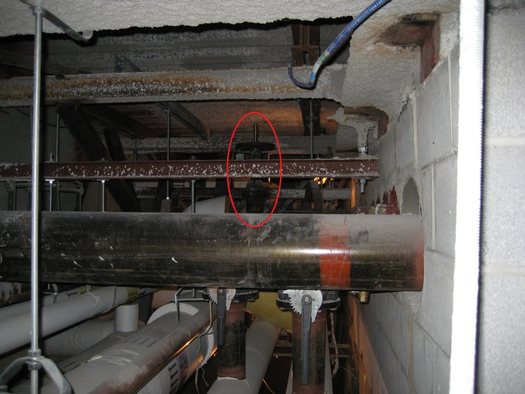 """An isolation valve on an 8"""" steam line serving a large building, 14 feet off the ground."""