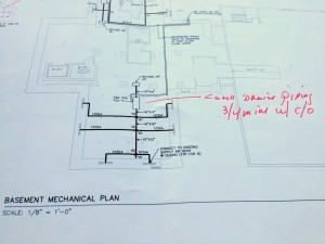 Commissioning design review notations on a mechanical drawing