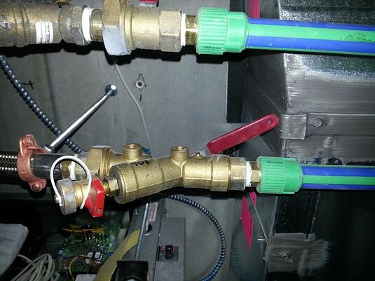Figure 4: A heat pump isolation valve is blocked by ductwork and can't be fully opened.