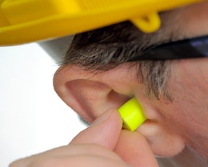 Man_inserting_earplugs.jpg